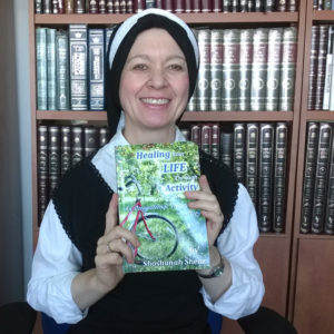 "Shoshanah with Proof Copy of her book ""Healing Your Life Through Activity"""