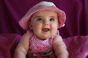 image of a baby in pink hat
