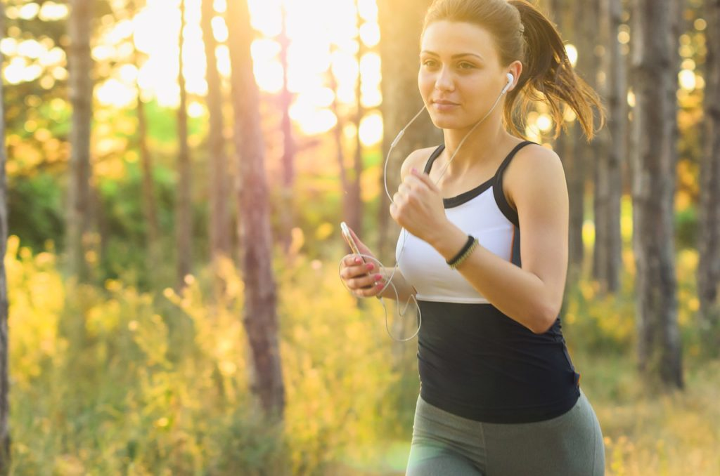 Woman Running to Indicate Adding Exercise to Your Routine
